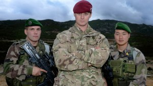 Image of Corporal Chris Hooper with Legionnaire Oskar Trompakajski (left) and Legionnaire 1st Class Jung Jih (right). British paratroopers have been training with their counterparts from the French Foreign Legion as the two units build a closer working relationship.