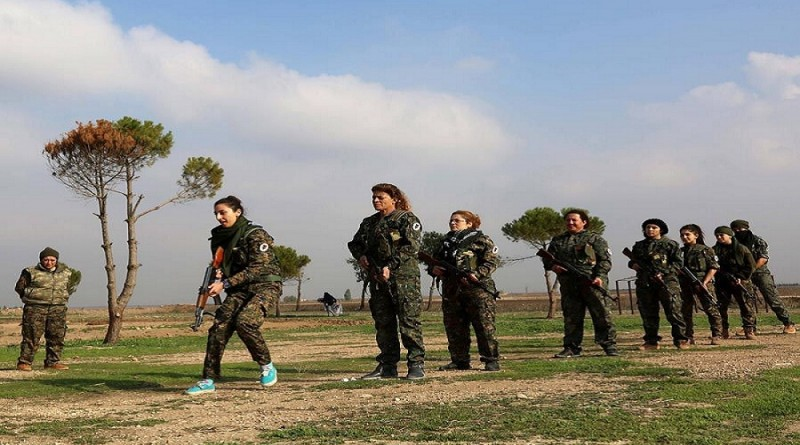 Syrian women are training to protect themselves and their children while many of the males are seeking refuge and not fighting back.