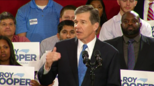 Attorney General Roy Cooper is a automaton of the Obama administration, say his detractors.