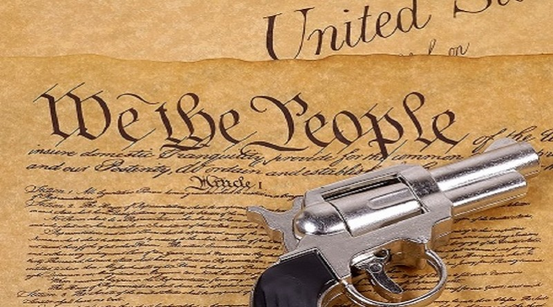Declaration of Independence and a Gun.  RIght To Bare Arms Concept.