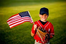 child baseball player and flag