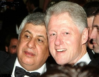 Bill Clinton keeping an eye on his $1 billion pledge by befriending a man who finances Hezbollah and other possible terror groups.