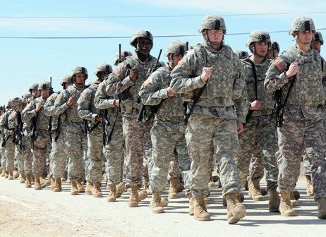 Soldiers from 53rd Infantry Brigade Combat Team march in formation after completing training at Ft. Hood, Texas, Feb. 25, 2010. The Florida Army National Guard Soldiers departed by plane from Ft. Hood in late-February and early-March for missions in Kuwait and Iraq. Photo by Spc. Karen Kozub