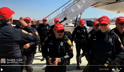 Police officers proudly wear Trump baseball caps after they endorsed him.