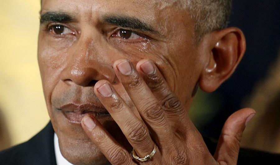 U.S. President Barack Obama wipes away tears.