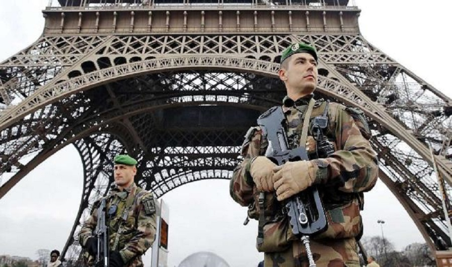 French police SWAT team members in front of the famed Eiffel Tower in Paris.