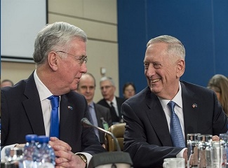 Defense Secretary Jim Mattis talks with Britain's Defense Secretary Michael Fallon during a North Atlantic Council meeting at NATO headquarters in Brussels, Feb. 15, 2017. (DoD photo by Air Force Tech. Sgt. Brigitte N. Brantley)