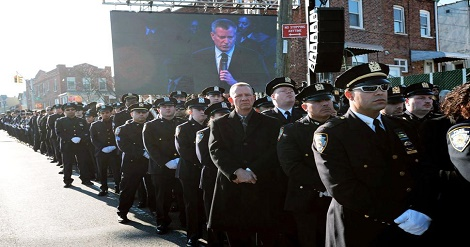 Numerous police officers turned their backs on Mayor de Blasio in protest of his anti-police comments.