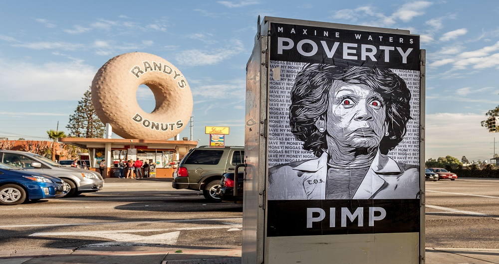 Maxine Waters Poverty Pimp Posters in front of famous Randy's Donuts in Los Angeles.