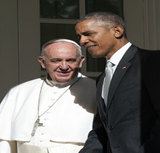 Pope Francis and President Barack Obama walk past the Rose Garden to the Oval Office. The Pope and Obama have much in common politically.