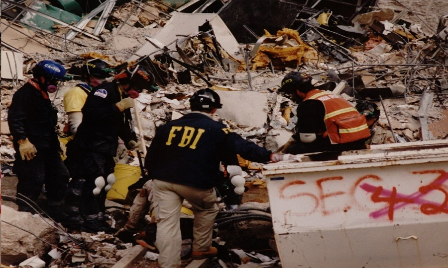 FBI agents examining the crime scene of a bomb incident.