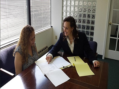 Heather Darling (right) discusses a legal matter with a client.