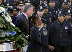 NYPD officers booed and turned their backs in a display of anger at the mayor of New York City.