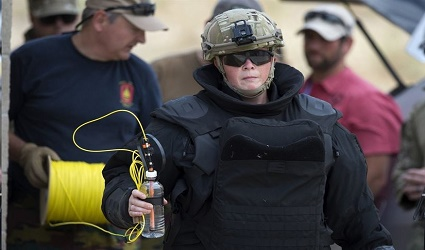 Belgian army First Sgt. Maj. Nele Van Keer prepares an explosive charge during the Raven's Challenge exercise at Camp Pendleton, Calif., Aug. 1, 2017. Raven's Challenge is an Army-funded exercise led by the Bureau of Alcohol, Tobacco, Firearms and Explosives, with support and participation from multiple federal, state and local agencies. DoD photo by EJ Hersom
